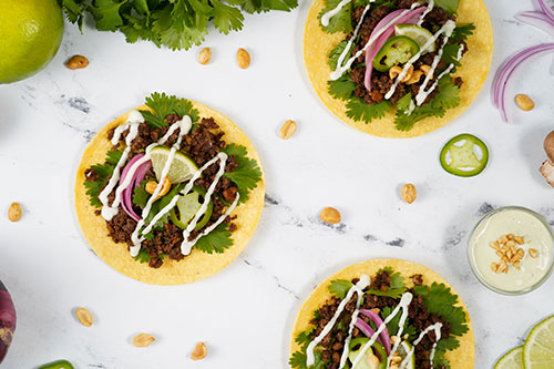 Peanut Tacos with Poblano Cream Sauce & Pickled Onions